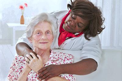 senior patient with friendly female nurse