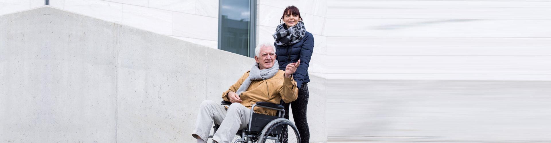 woman guiding old man